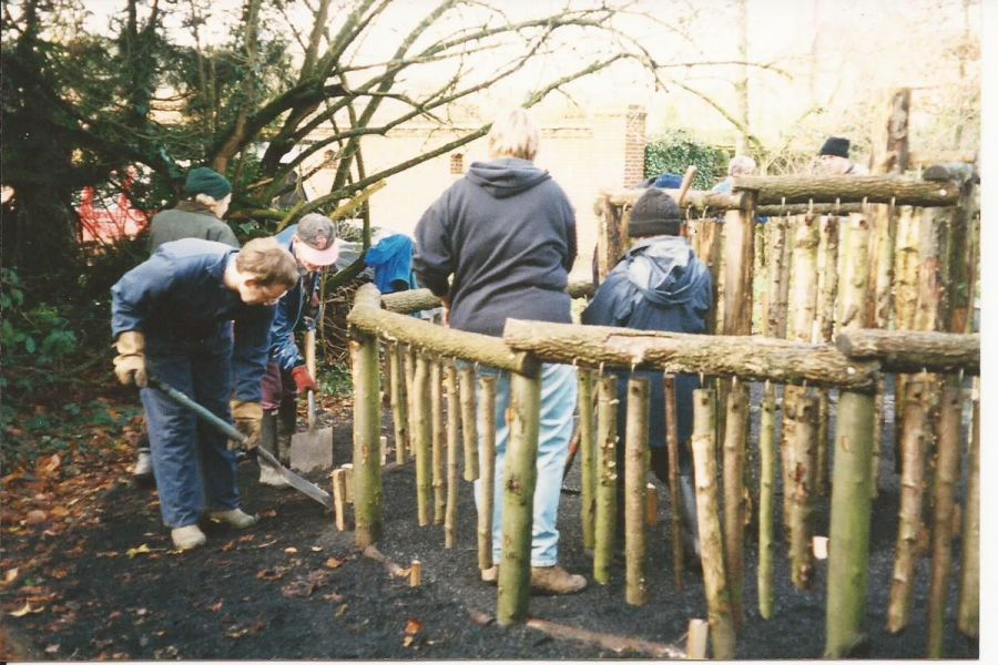 Special needs group building fence structure at Bore Place